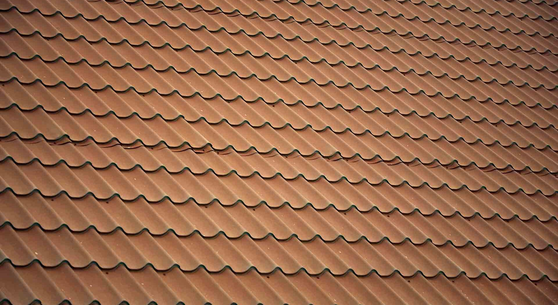 What are The Pros and Cons of a Metal Roof vs Shingles?